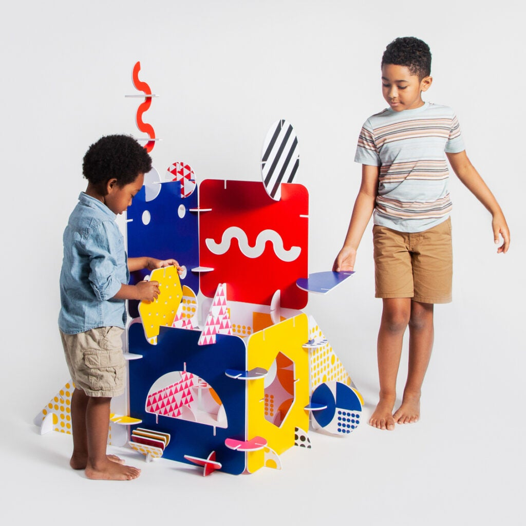 two kids buildign fort