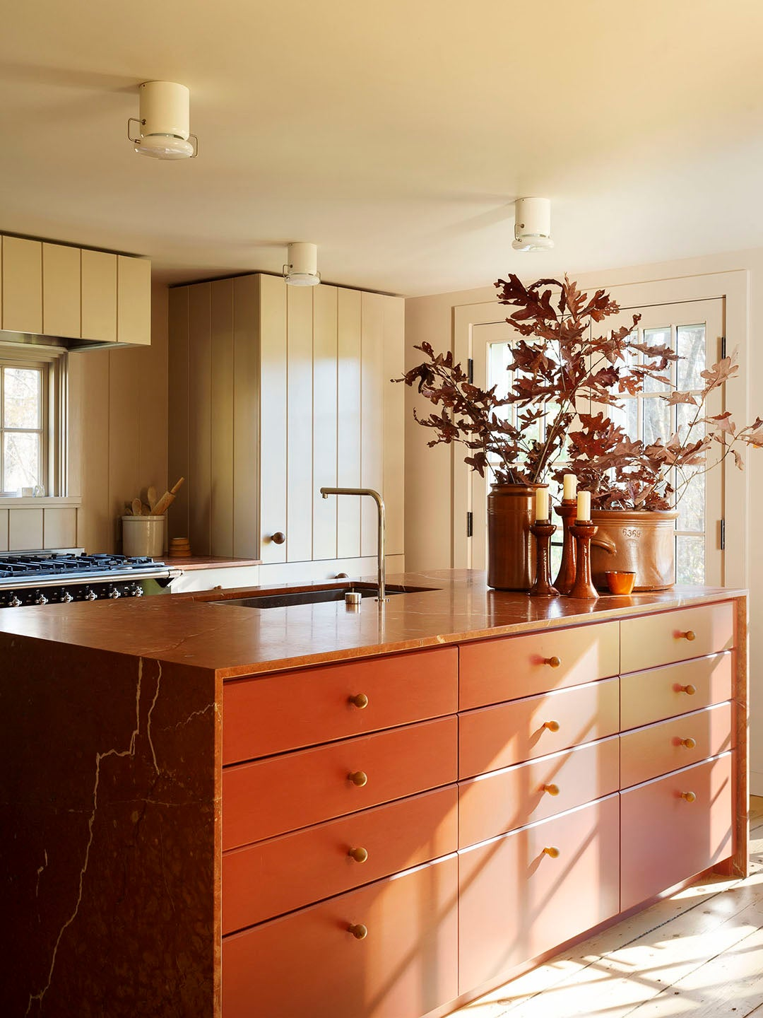 kitchen with large red island