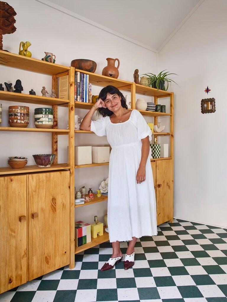 woman leaning on shelf