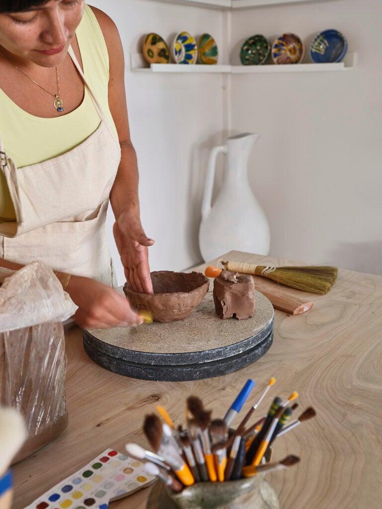 woman making ceramics