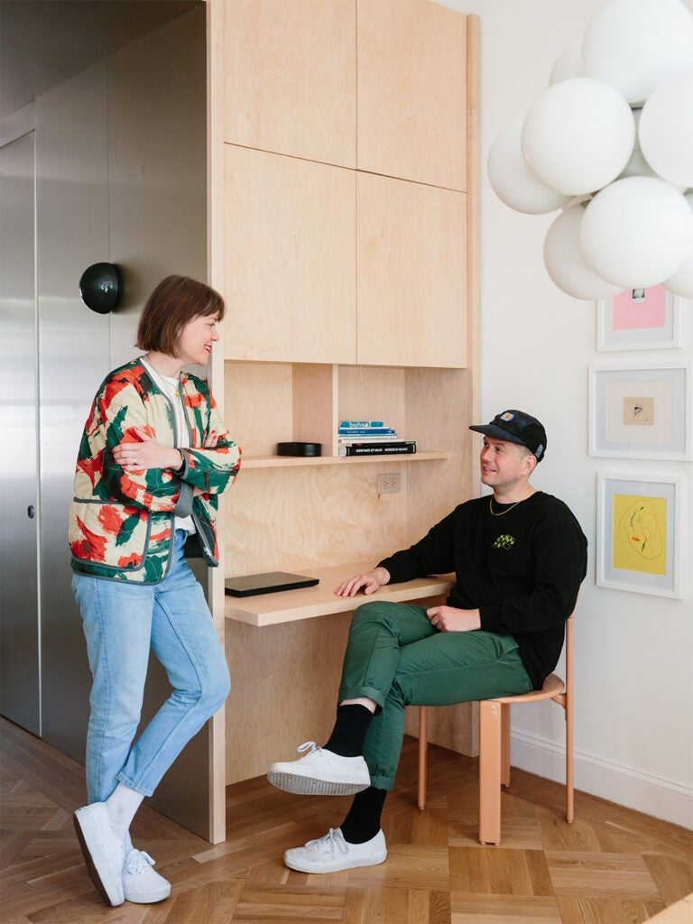 couple sitting at kitchen desk