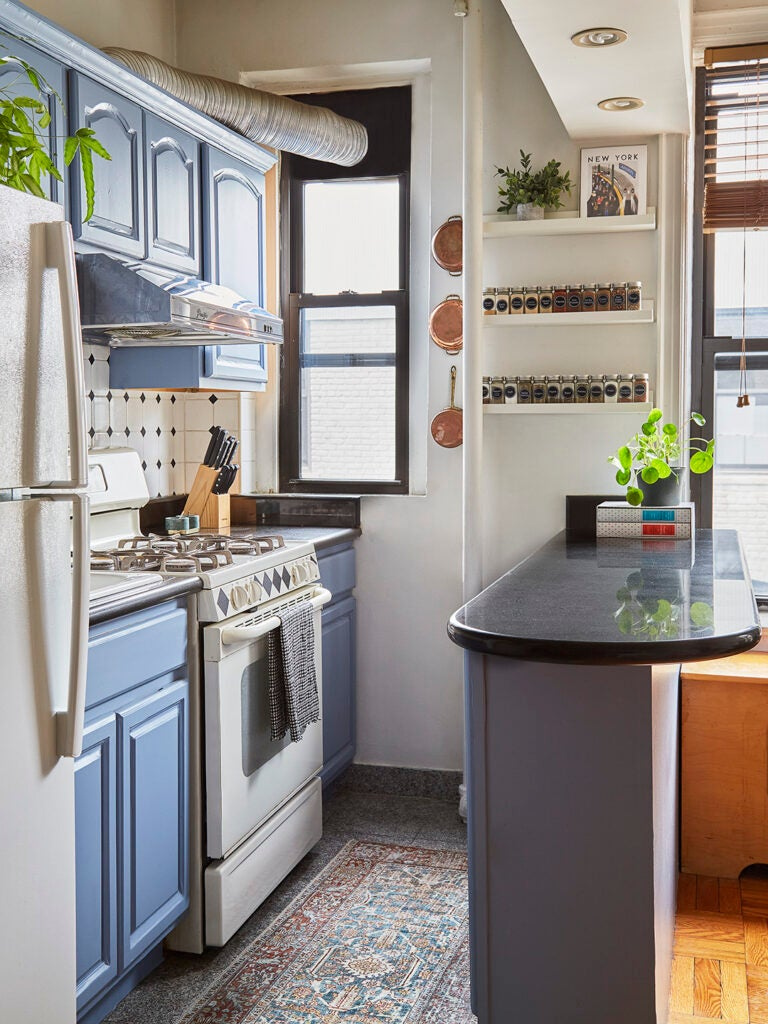 kitchen with blue cabinets and black countertops