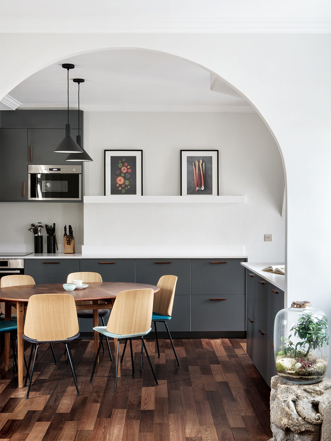 kitchen with wood floors and grey cabients