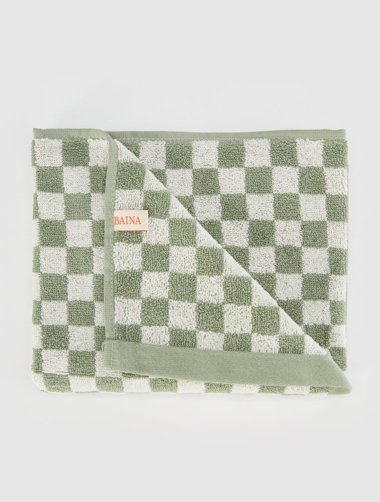 green and white checkered towel