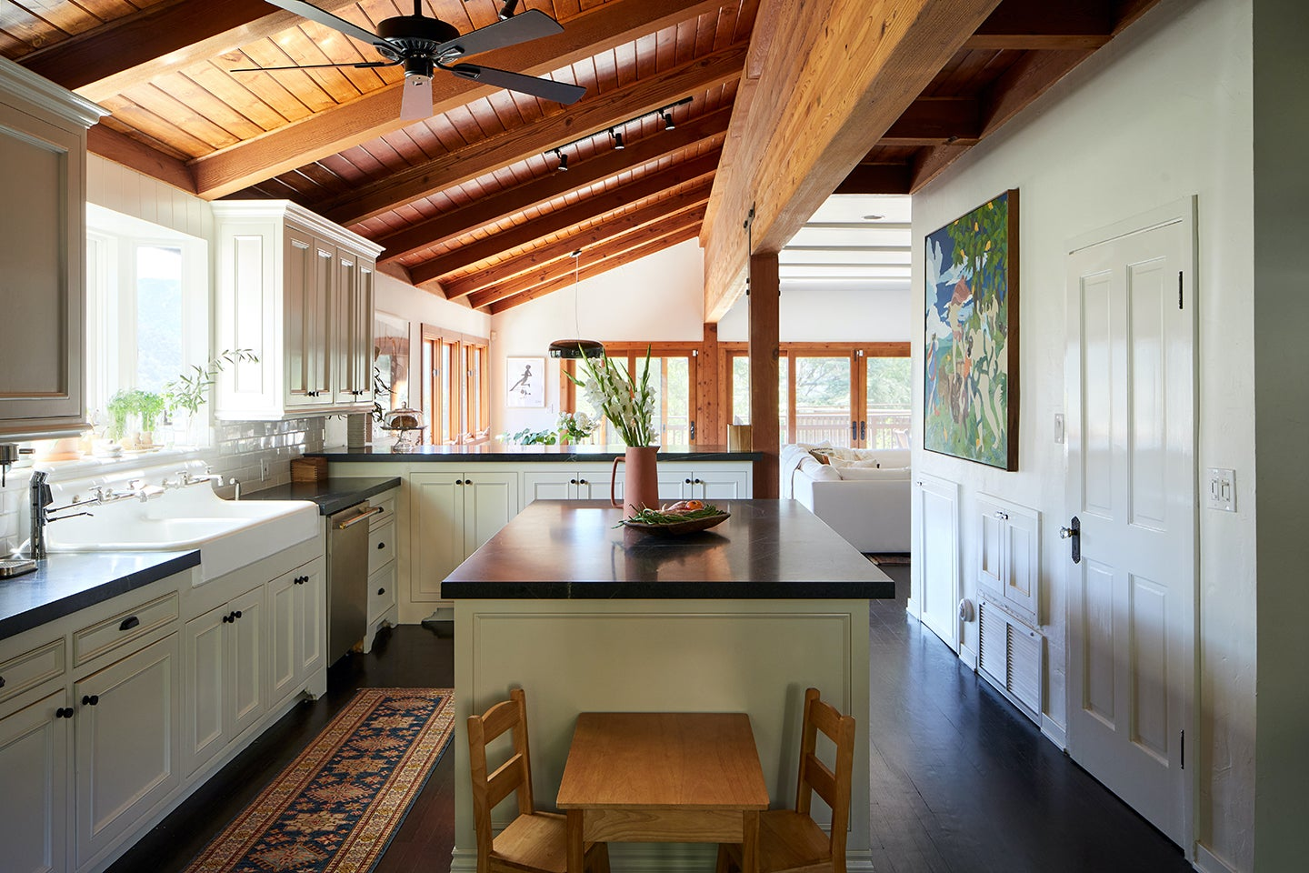 kitchen with island and wooden kids table