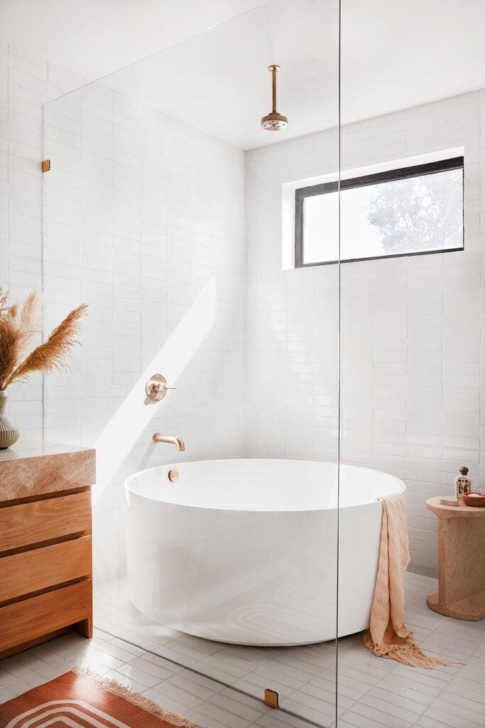 round tub in glass shower