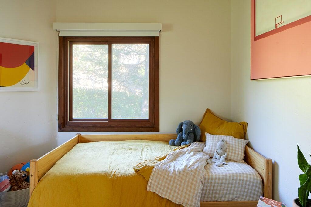 kid's bedroom with yellow bedding.