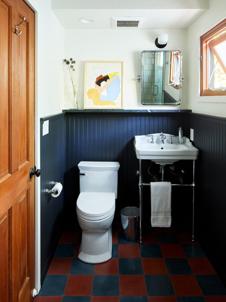 blue bathroom with checkered floors.