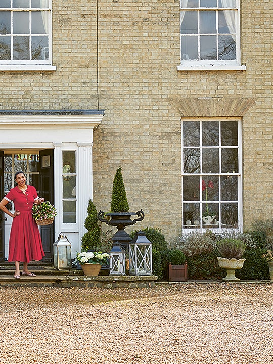 Paula Sutton in front of her home in the country