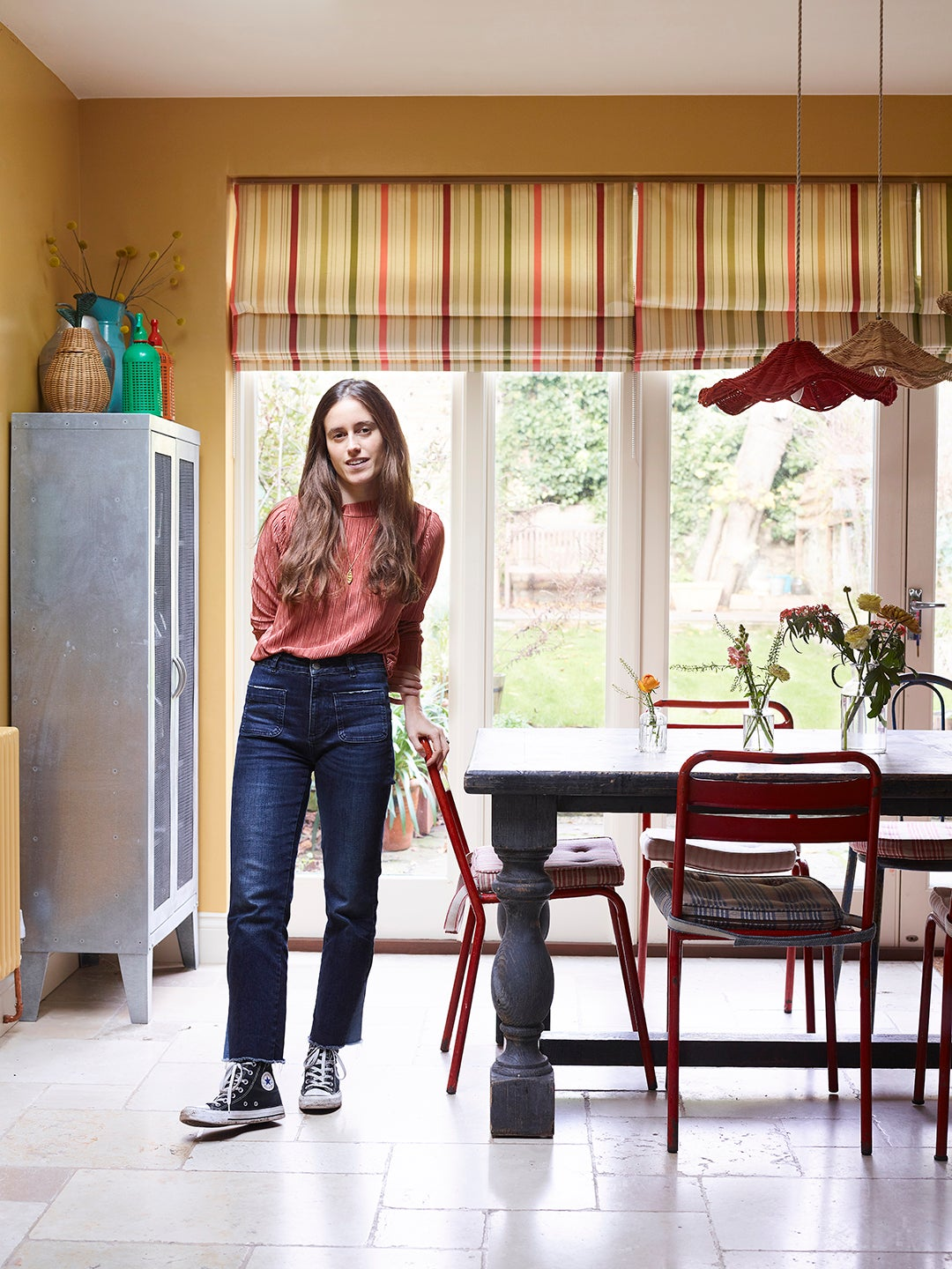 woman standing in yellow kitchen