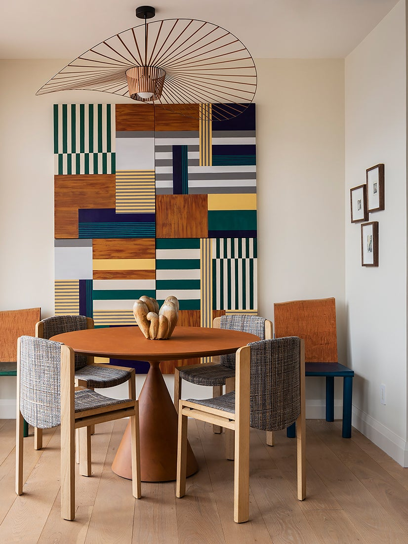 colorful dining room with graphic art on the wall